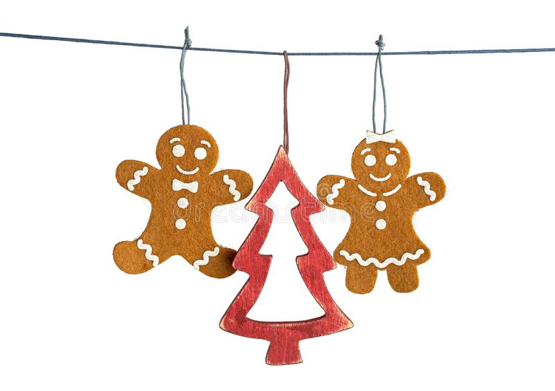 Gingerbread man decorations isolated. Gingerbread man decorations and Christmas tree hanging on string isolated on white background royalty free stock image