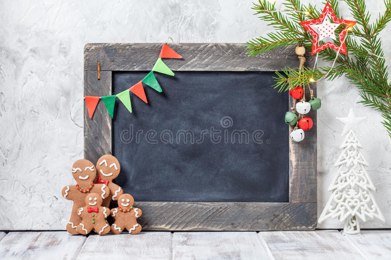 Gingerbread man family and chalkboard. Christmas decoration with Happy Gingerbread man family and chalkboard stock photos