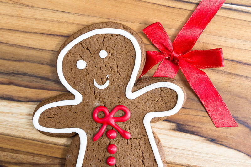 Gingerbread man. Holiday classic, a gingerbread man cookie on a wooden table royalty free stock photo