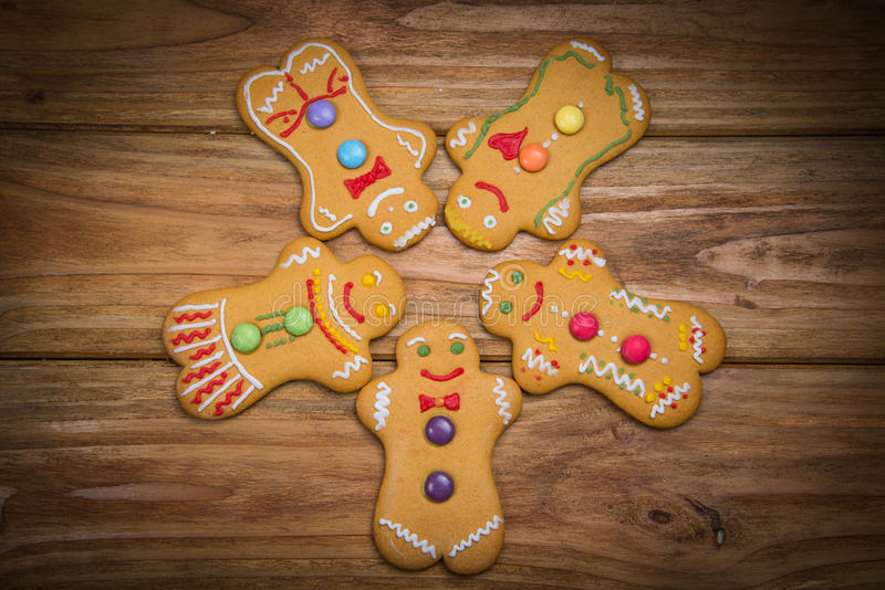 Gingerbread man. Home made gingerbread man decorating for Christmas on wooden background stock photos