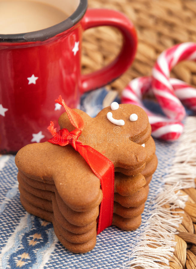 Gingerbread man. Homemade gingerbread man cookie with red ribbon royalty free stock image