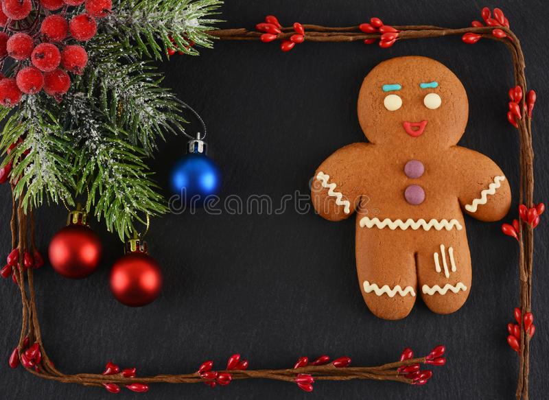 Gingerbread Man lying on dark background. Christmas or New Year composition. Christmas card stock photography