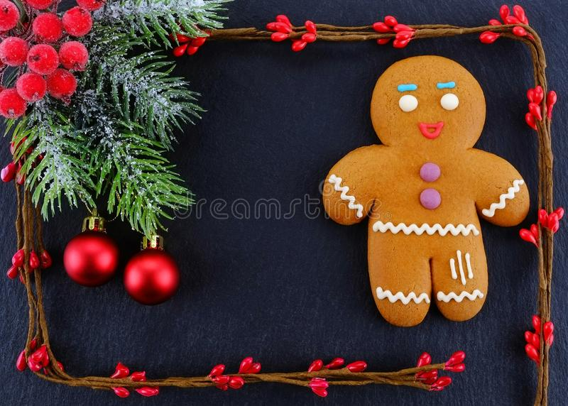 Gingerbread Man lying on dark background. Christmas or New Year composition. Christmas card. stock photo