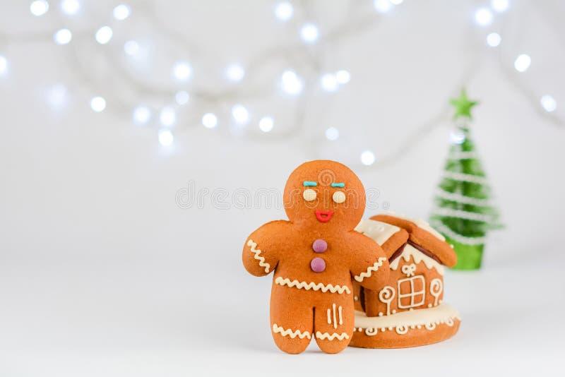 Gingerbread man near the house. Christmas food decoration. Gingerbread man near the house. Christmas food decoration stock photography