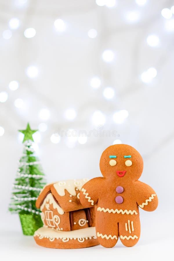 Gingerbread man near the house. Christmas food decoration. stock photos