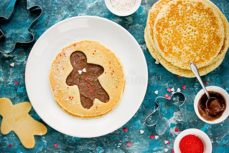 Gingerbread man pancake. Sweet pancake with chocolate and sugar stock images