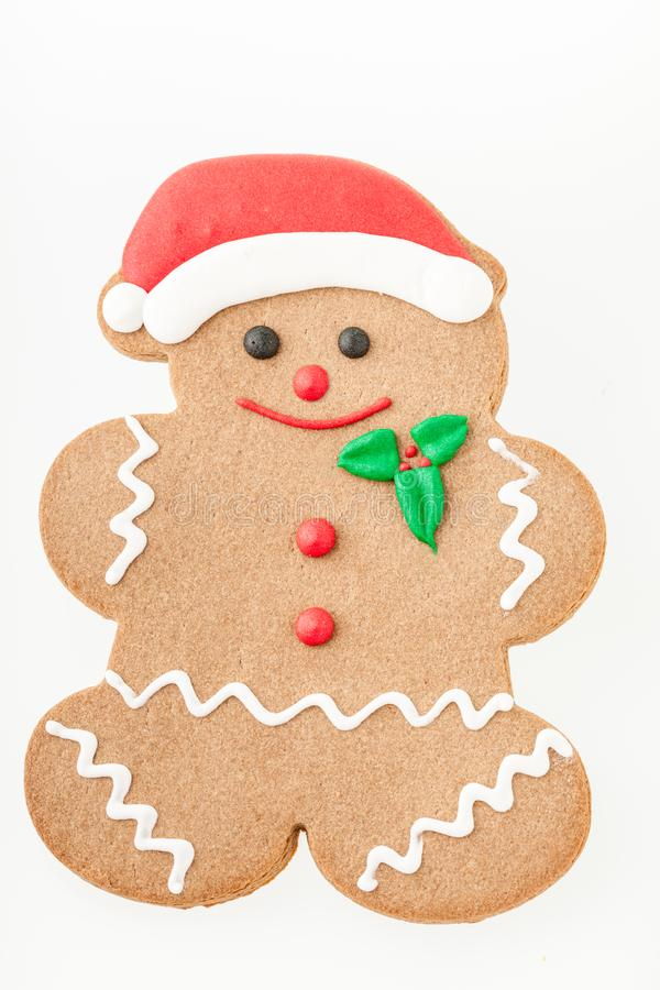 Gingerbread man with Santa frosting hat, beaming smile stock image