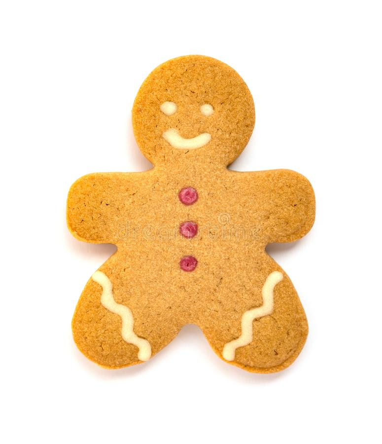 Gingerbread man with a smiling face on white background. Gingerbread man with a smiling face on a white background royalty free stock photography