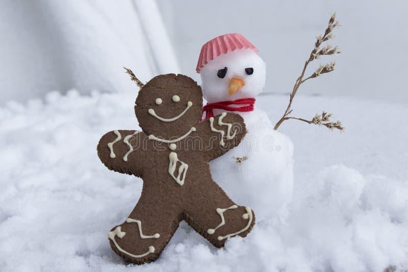 Gingerbread Man and Snowman stock photos
