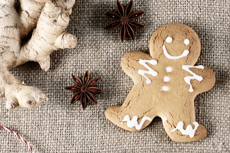 Gingerbread man - the symbol of the new year with ginger and anise. On a linen cloth - top view royalty free stock photo