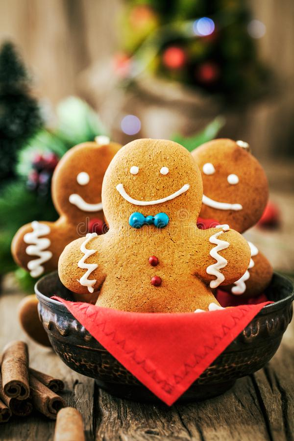 Gingerbread man on table. Christmas food. Gingerbread man cookies in Christmas setting. Xmas dessert stock image