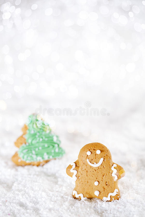 Download Gingerbread Man And Tree On A Festive Christmas Snow Background Stock Photo - Image: 31970318