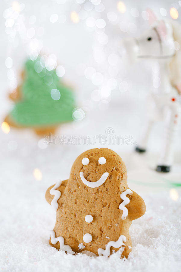 Gingerbread man and tree on a festive Christmas snow background. Nice postcard royalty free stock images