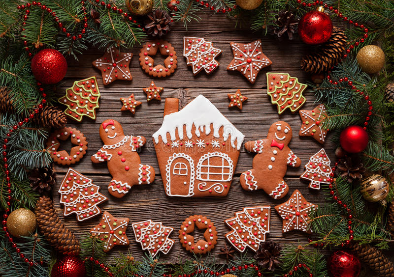 Gingerbread man and woman couple, house, fir trees royalty free stock photos