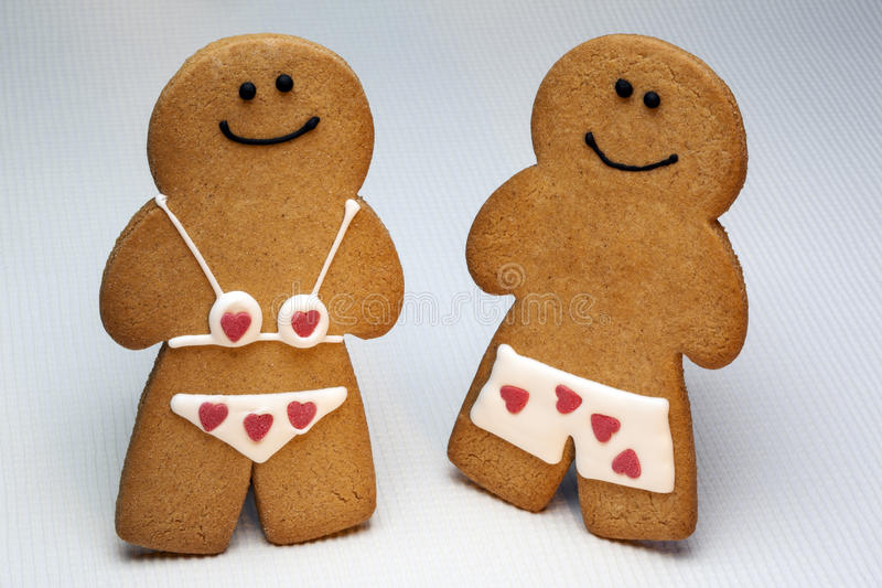 Gingerbread Man and Woman. Gingerbread dates back to the 15th century and the first documented instance of figure-shaped gingerbread biscuits was at the court royalty free stock images
