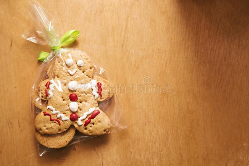 Gingerbread man on the wooden table. Photo of gingerbread man on the wooden table stock images