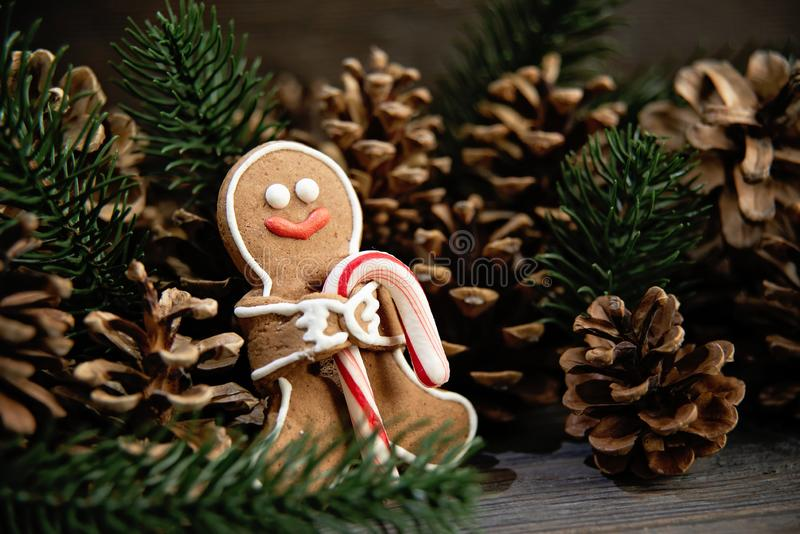 Gingerbread men laying on wood background. Christmas or New Year composition stock images