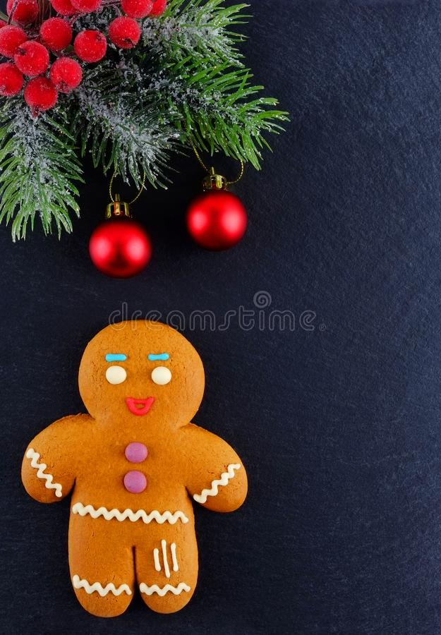 Gingerbread Man lying on dark background. Christmas or New Year composition. Christmas card stock images