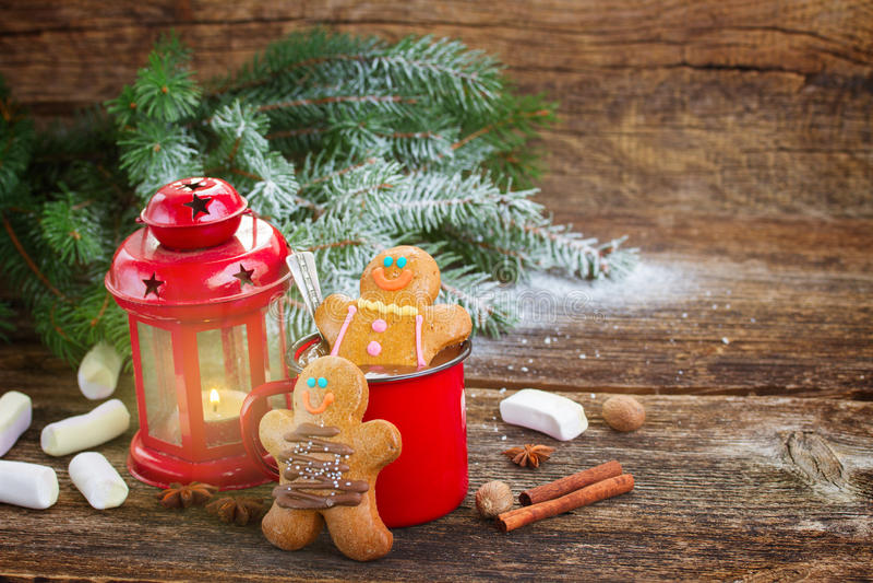 Gingerbread men with mug of hot chocolate stock photo