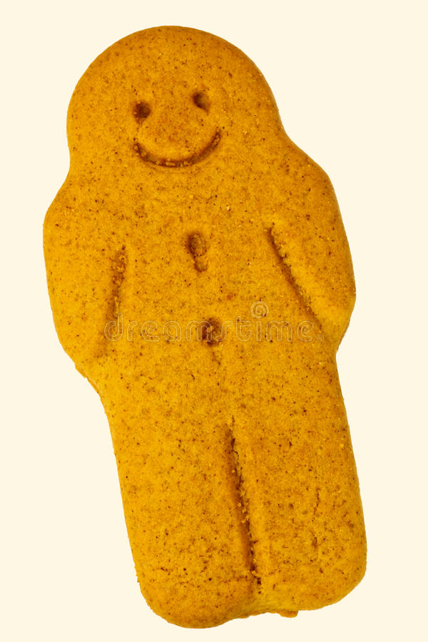 Gingerbread man. A smiling gingerbread man, isolated on a white background royalty free stock images