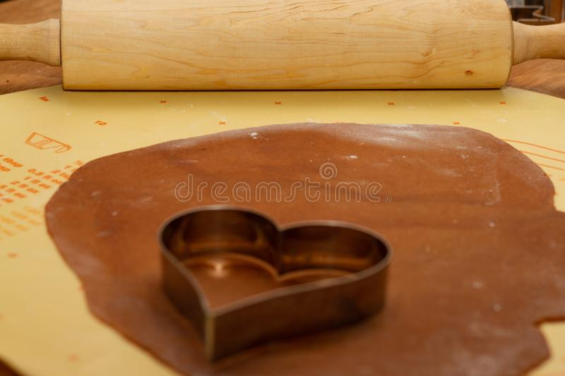 Gingerbread pastry with heart-shaped cutting form stock photos