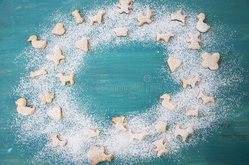 Gingerbread with powdered sugar on wooden background. Christmas cookies. Copy space. stock photography