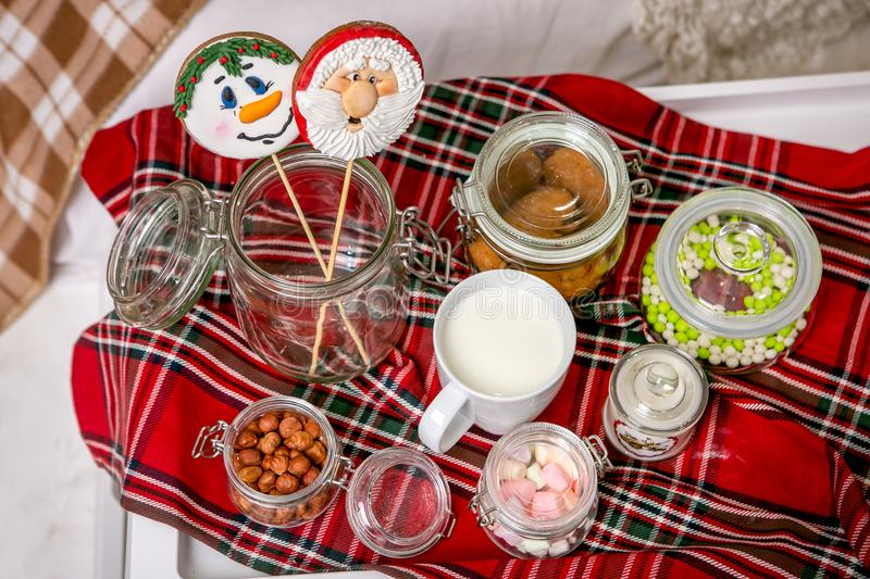 Gingerbread snowman and Santa on a stick on the breakfast table in the bedroom. Holiday sweets. New Year and Christmas theme. Fest royalty free stock image