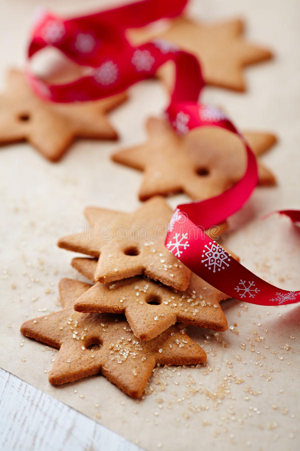 Gingerbread stars on bakery paper royalty free stock images
