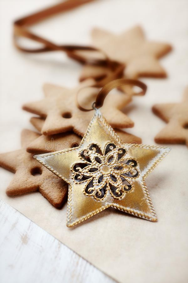 Gingerbread stars on baking paper royalty free stock photo