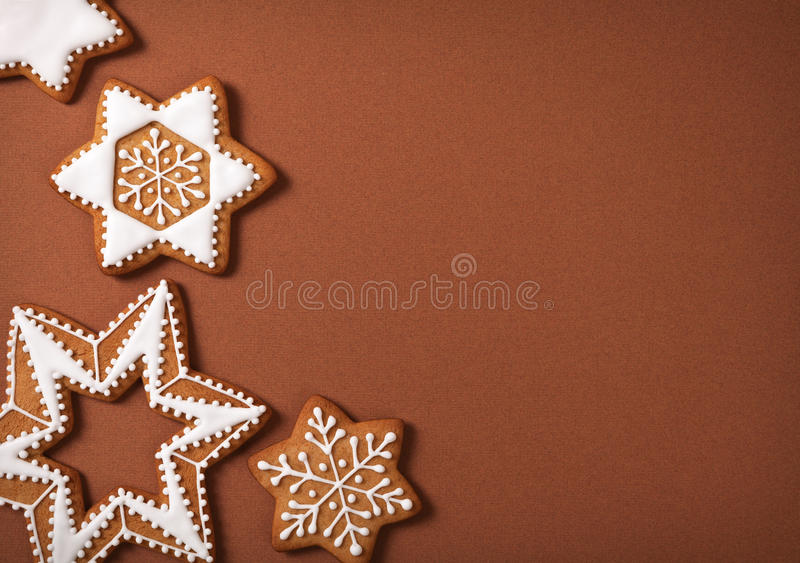 Gingerbreads. Christmas gingerbread stars on brown paper background. Top view royalty free stock photos