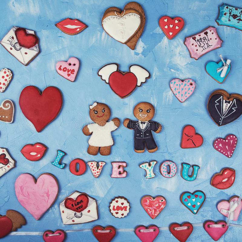 Gingerbreads for Valentines Day. Or Marriage on blue concrete background stock image