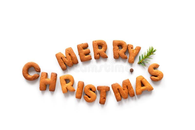 Gingerbrood zegt Merry Kerstmis in de vorm van een vis als symbool van het christendom stock afbeelding