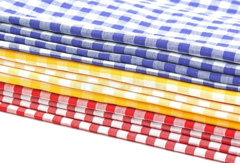 Gingham. Pile of Red, Yellow and Blue Gingham Cloths stock photo