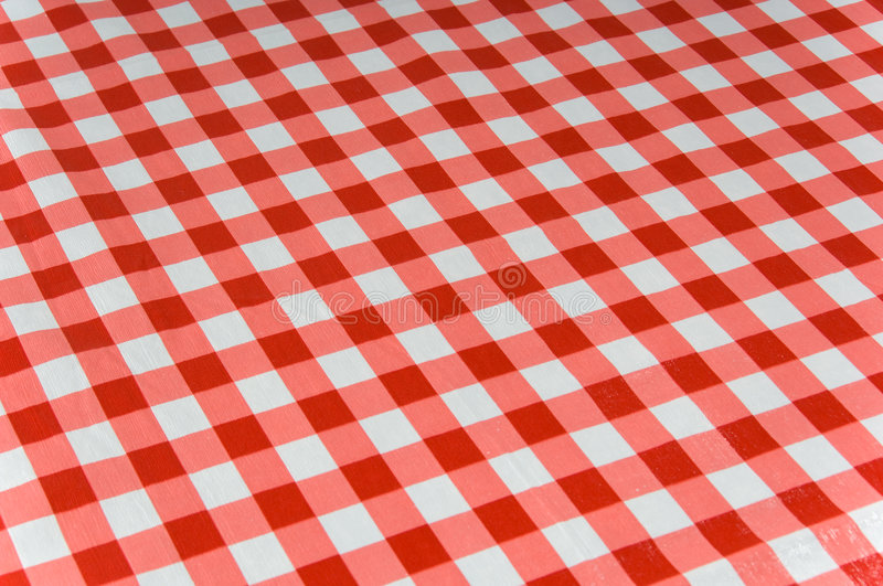 Gingham background. Gingham checked tablecloth background red and white royalty free stock photo