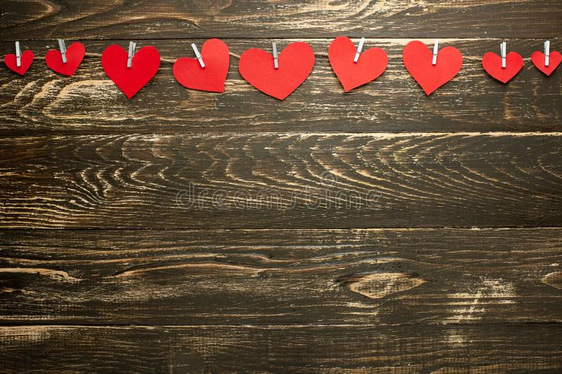 Gingham Love Valentine`s Hearts natural cord and red hearts with a rustic snag texture background, copy space, layout for design, royalty free stock photos