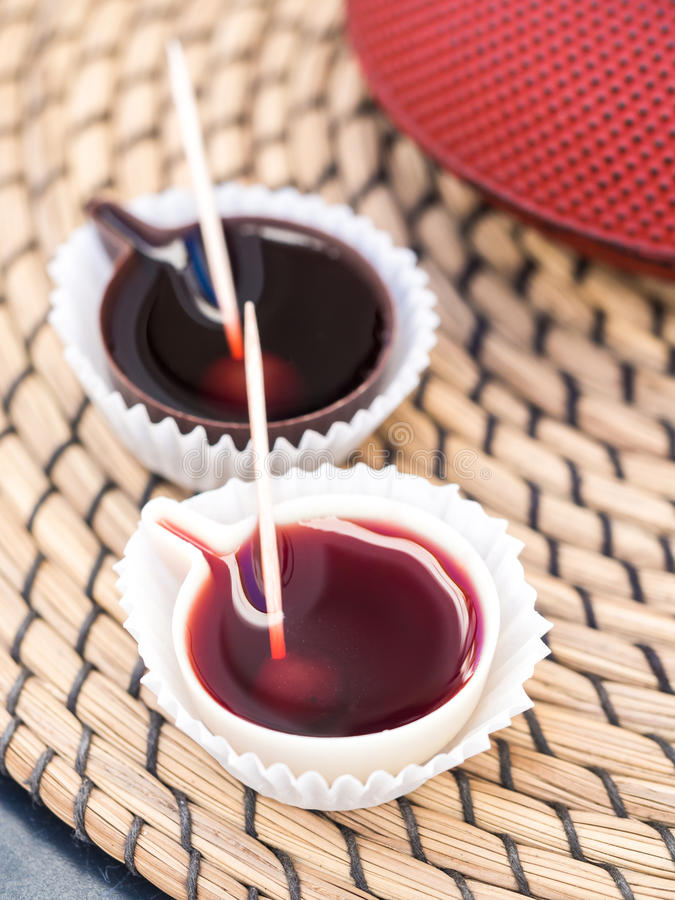 Ginja de Obidos, traditional sour cherry liquor, served in small. Cups made of chocolate royalty free stock photos