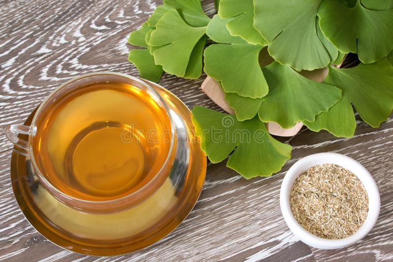 Ginkgo tea in a glass cup royalty free stock photo