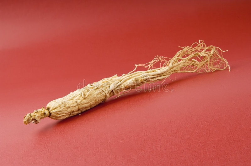 Ginseng on red. The ginseng on the red background stock photos
