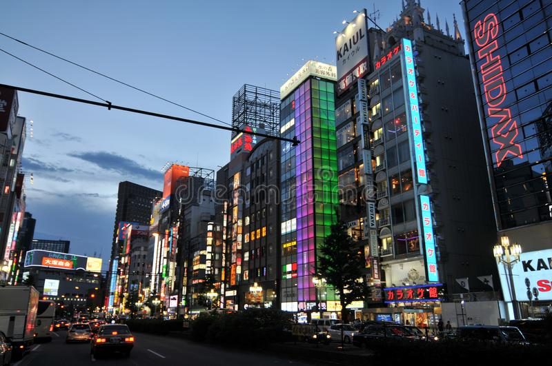 Ginza district with illuminated buildings at night. Ginza, Tokyo, Japan - 9th July 2018 : Beautiful night view of the Ginza area in Tokyo, the most popular royalty free stock image