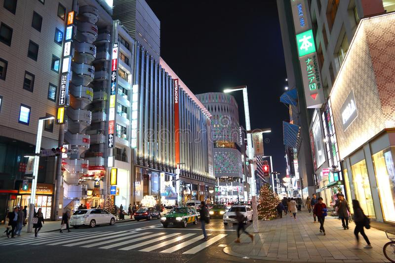 Ginza district, Tokyo. TOKYO, JAPAN - DECEMBER 4, 2016: Night in Ginza district of Tokyo, Japan. Ginza is a legendary shopping area in Chuo Ward of Tokyo royalty free stock images