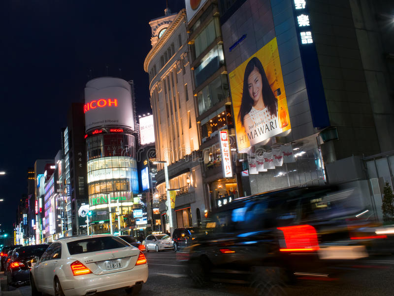Ginza shopping district in tokyo japan. Ginza, Tokyo, Japan - November 12, 2015: Ginza is a district of Chuo, Tokyo is a popular upscale shopping area of Tokyo royalty free stock photo