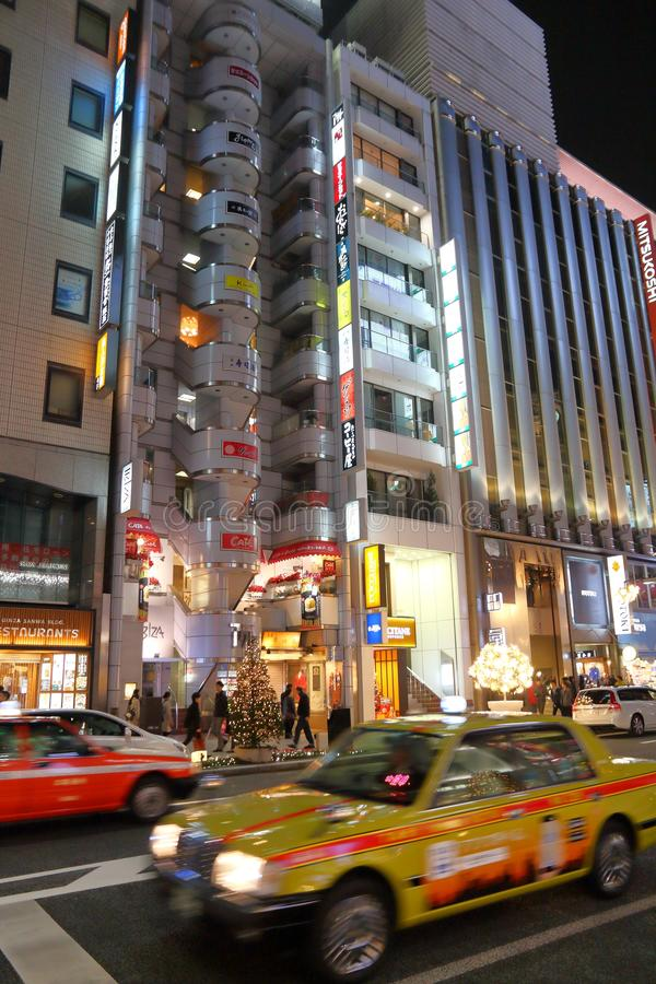 Ginza street, Tokyo. TOKYO, JAPAN - DECEMBER 4, 2016: Night in Ginza district of Tokyo, Japan. Ginza is a legendary shopping area in Chuo Ward of Tokyo royalty free stock photos
