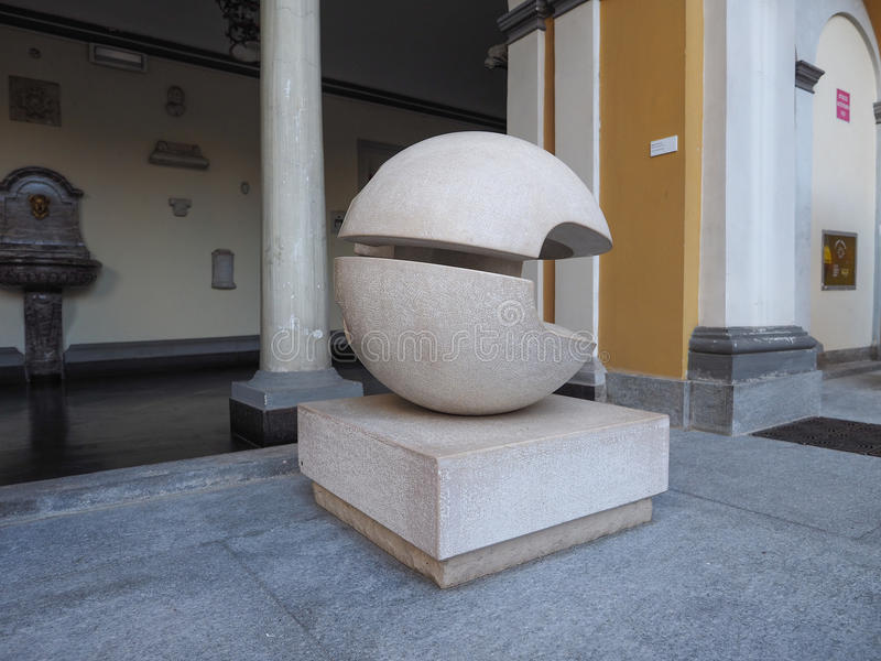 Gio Pomodoro sculpture in Turin. TURIN, ITALY - CIRCA AUGUST 2017: Stone sculpture entitled Guscio (meaning Shell) by artist Gio Pomodoro outside Accorsi Ometto stock photography
