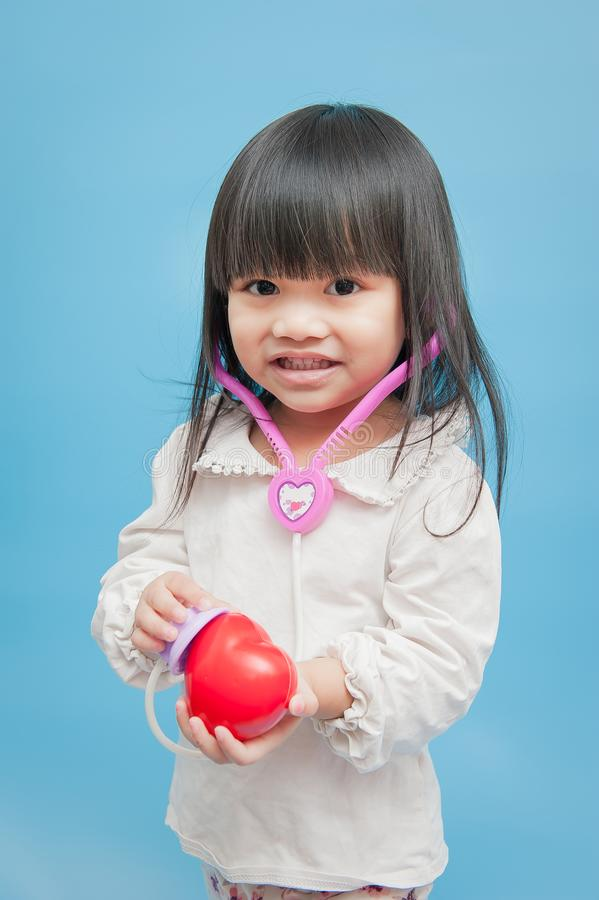 Giocando come medico, malattia cardiaca immagine stock libera da diritti