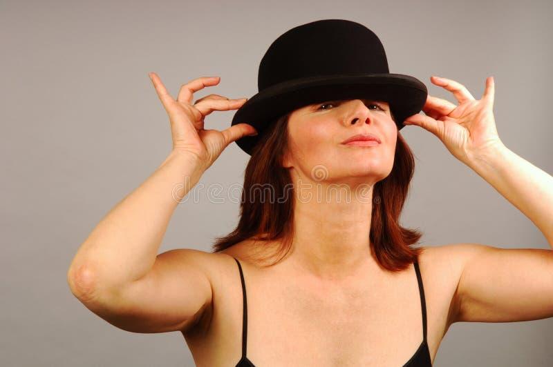 Giocando con il cappello immagini stock