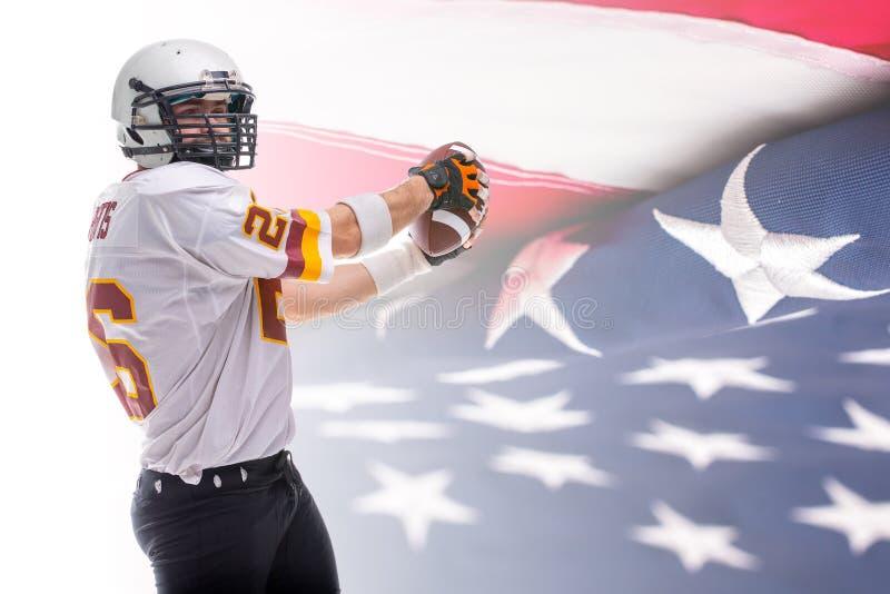 Giocatore di football americano barbuto nell'azione fotografia stock libera da diritti