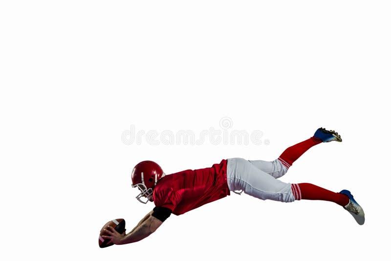 Giocatore di football americano che prova a segnare fotografia stock