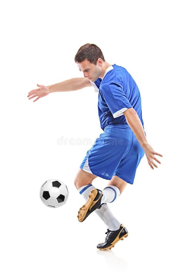 Giocatore di football americano con la sfera fotografia stock