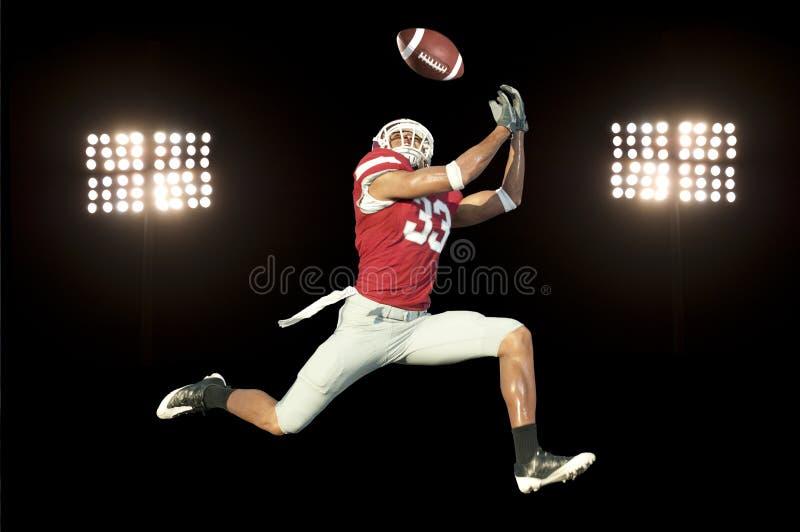 Giocatore di football americano con la sfera immagini stock