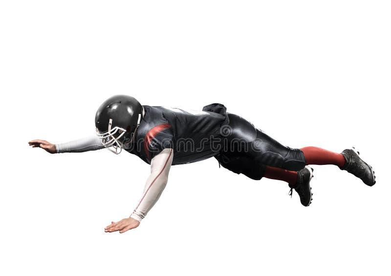 Giocatore di football americano nel bianco isolato azione fotografia stock libera da diritti